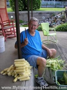 Popaw shucking corn