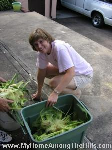 Emily with corn husks