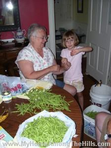 Mom and Abigail doing beans