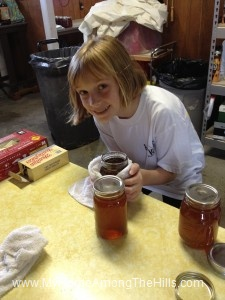 Helping with the honey harvest