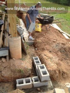 Grandpa laying concrete blocks
